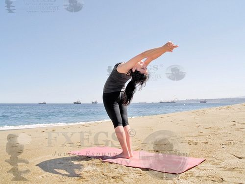 Bikram-yoga-arda-chandrasana-pose-at-beach